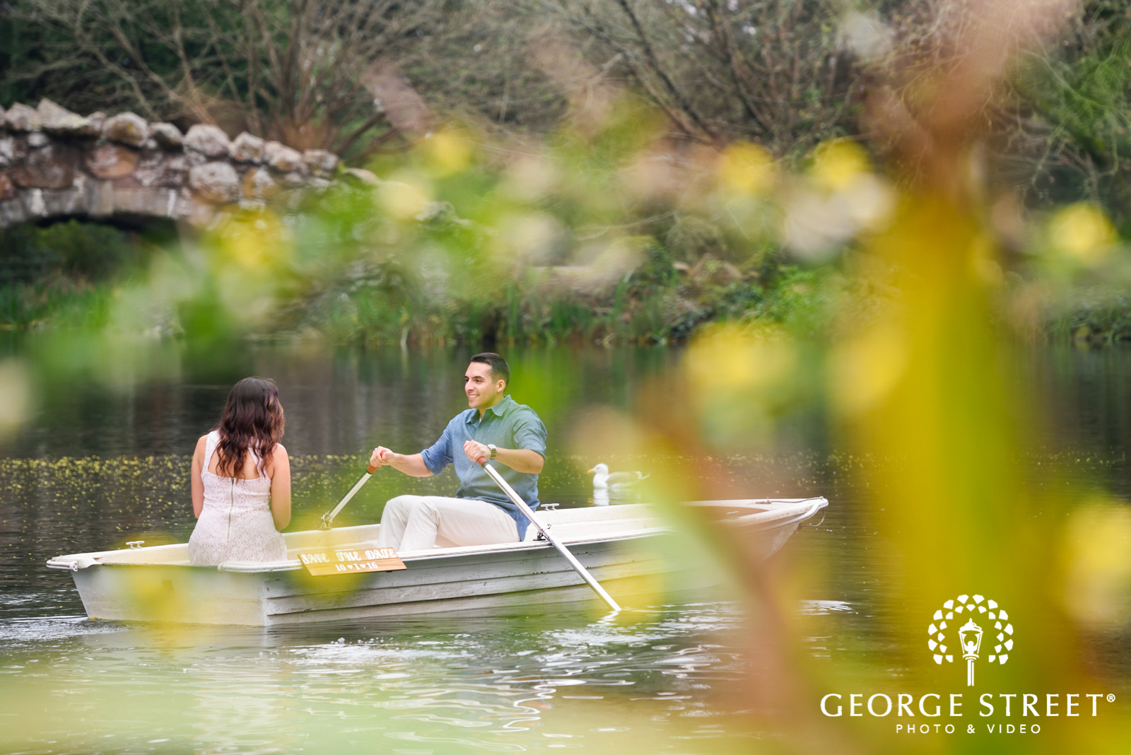 engagement photos in a rowboat