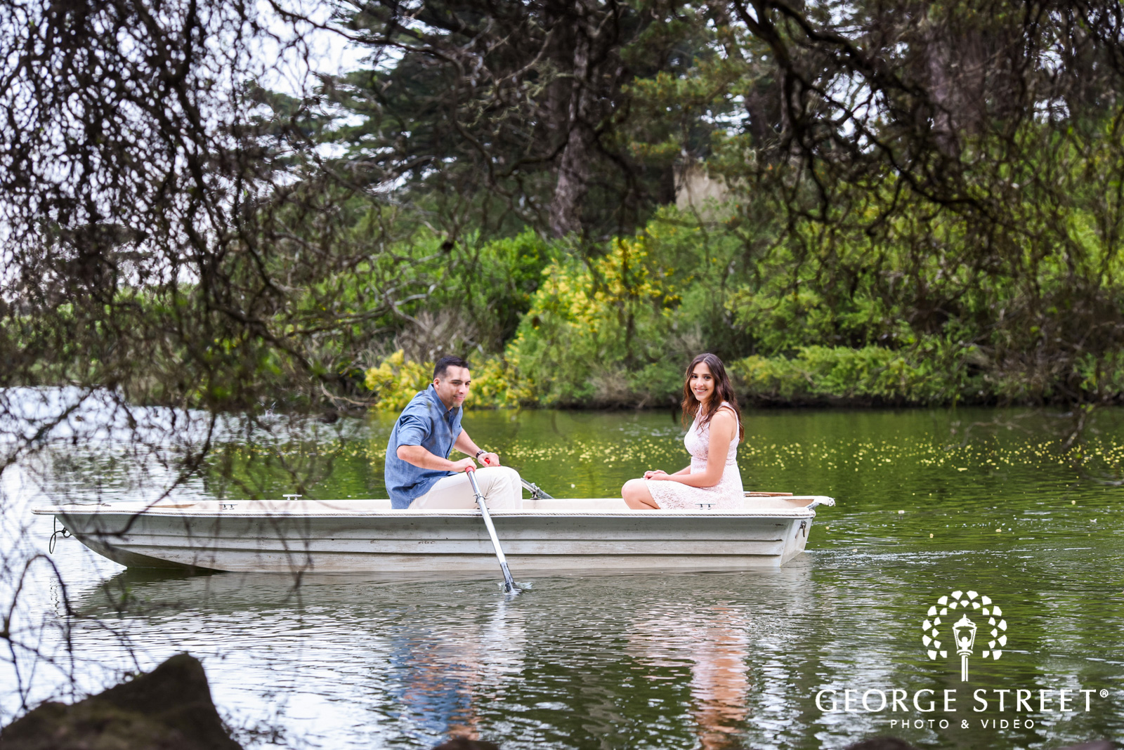 rowboat on lake engagement photos 2