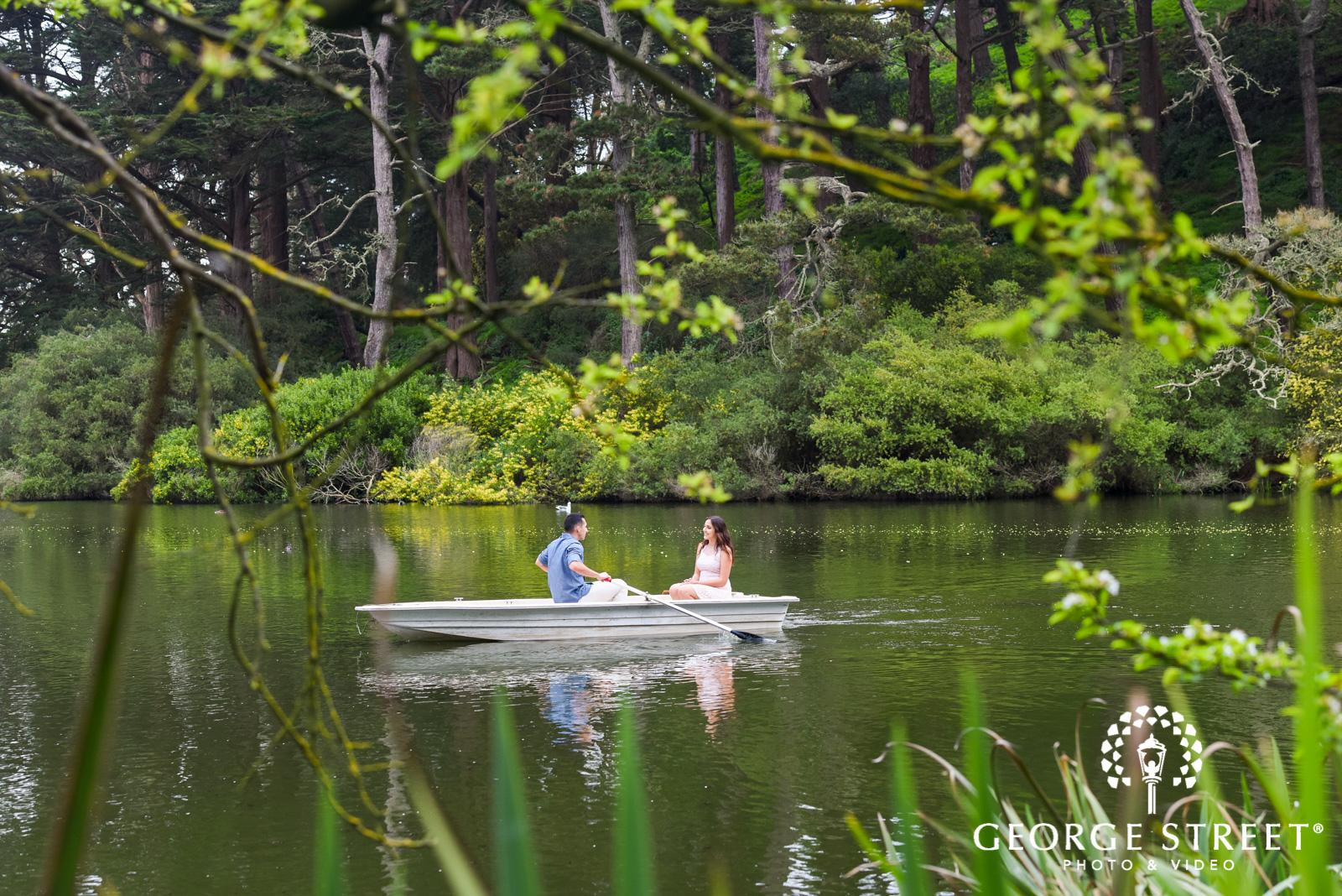 rowboat on lake engagement photos 3