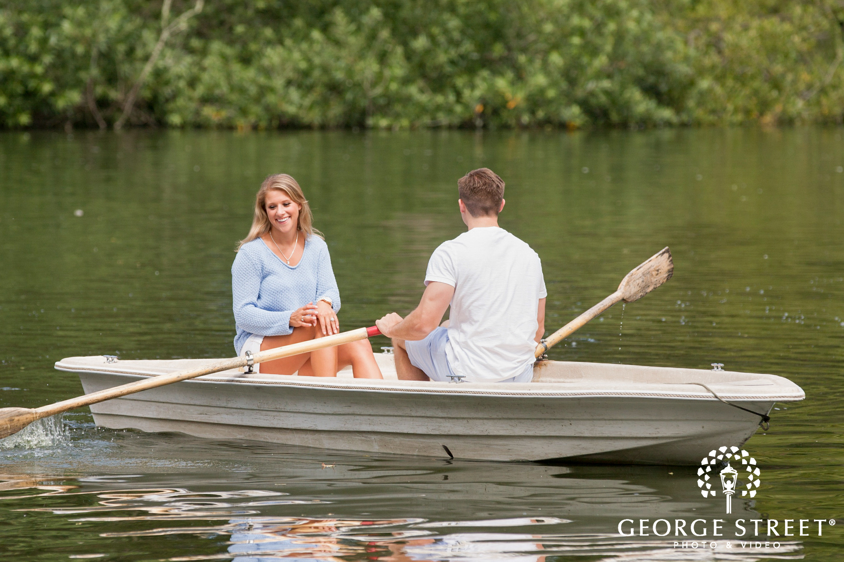 couple rowing boat engagement