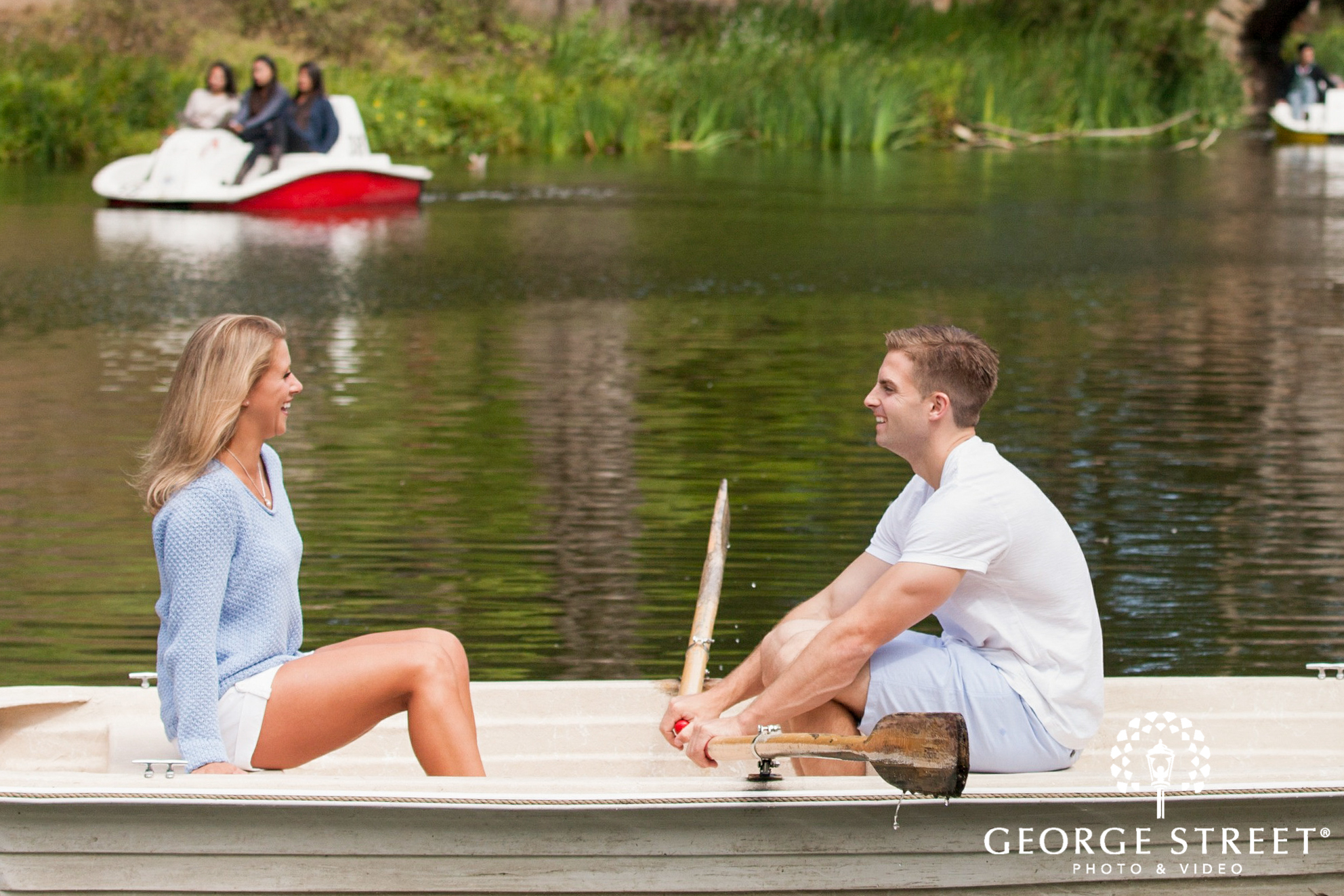 engaged couple in boat