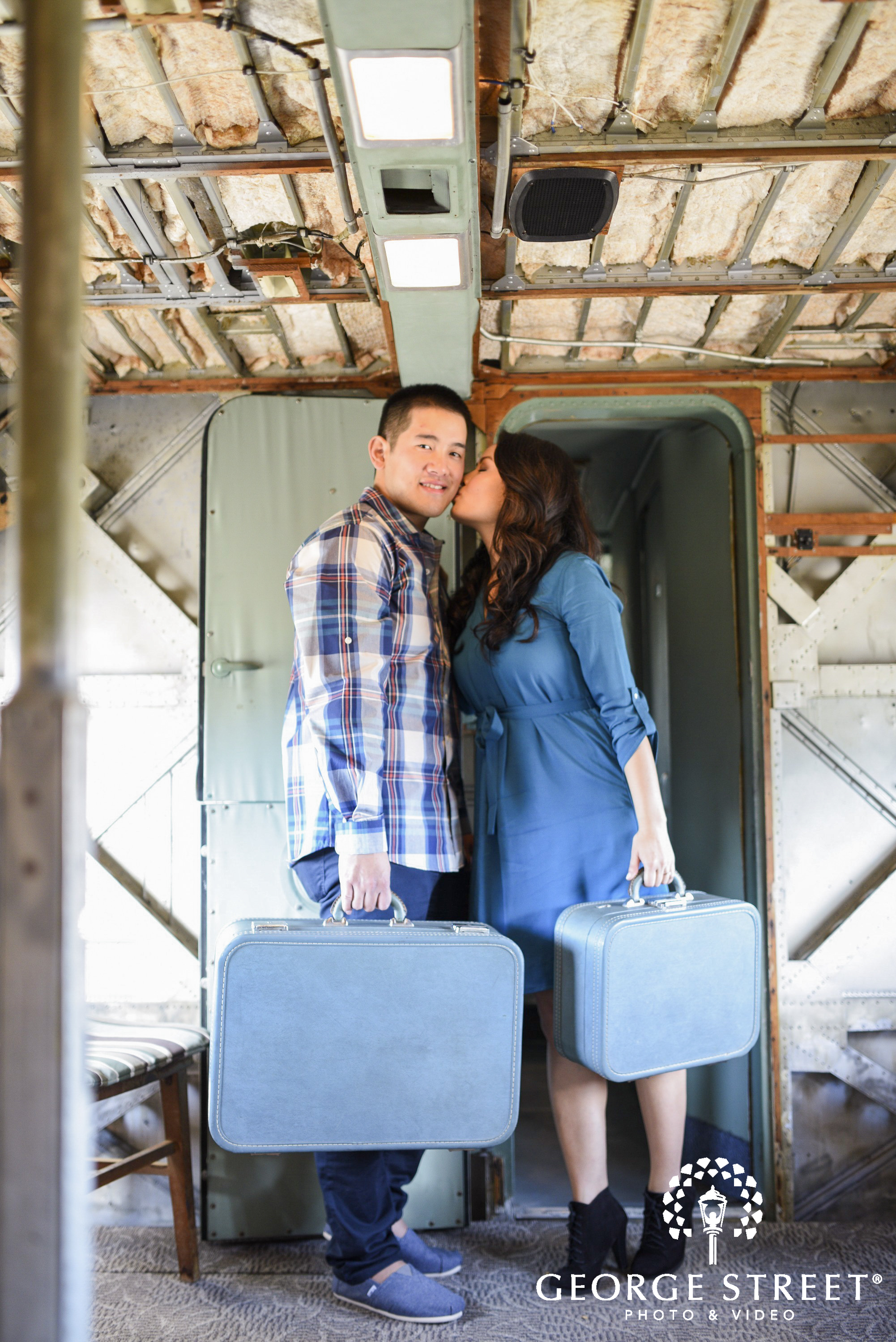 engaged couple traveling with suitcases