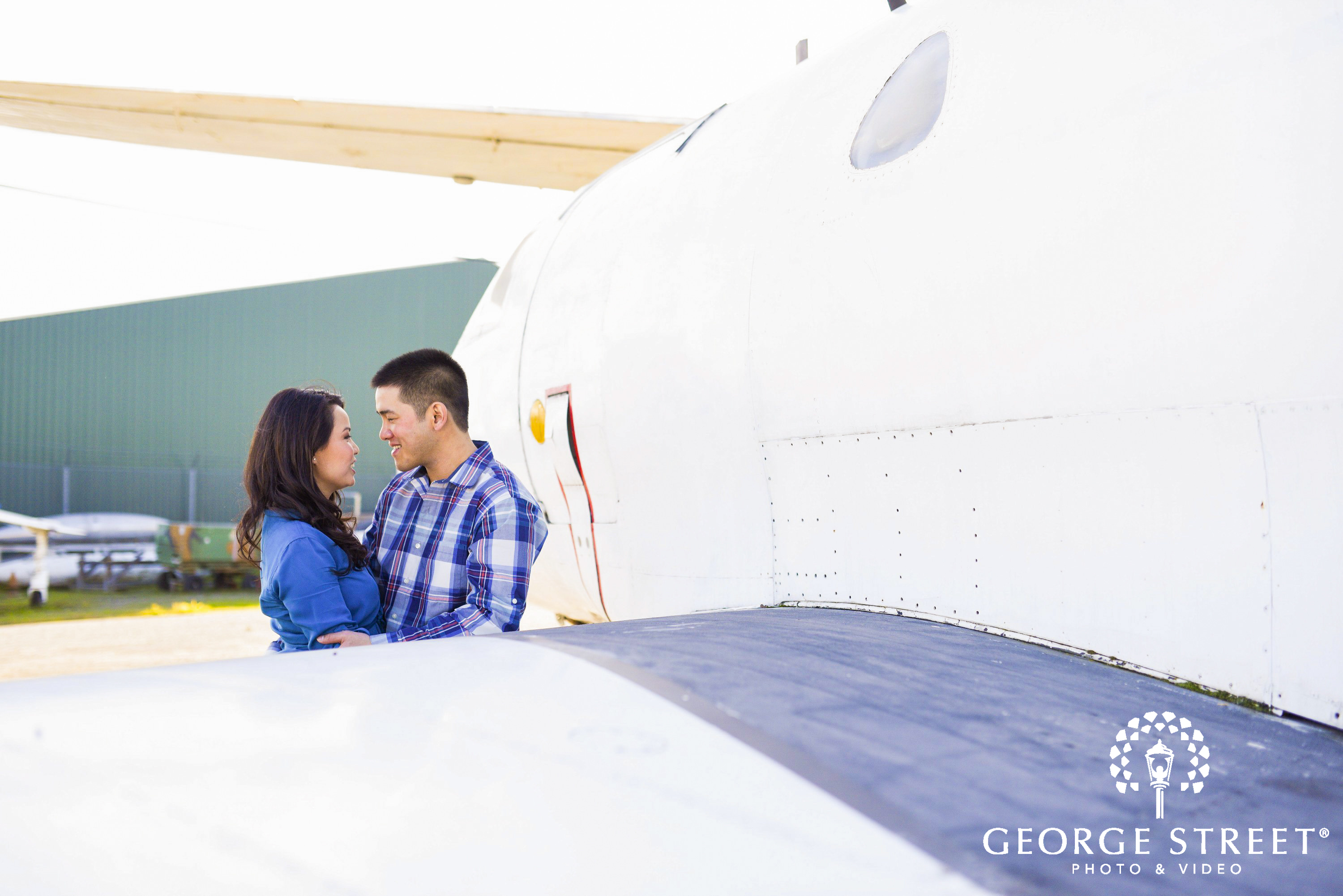 couple at airport gazing into each others eyes