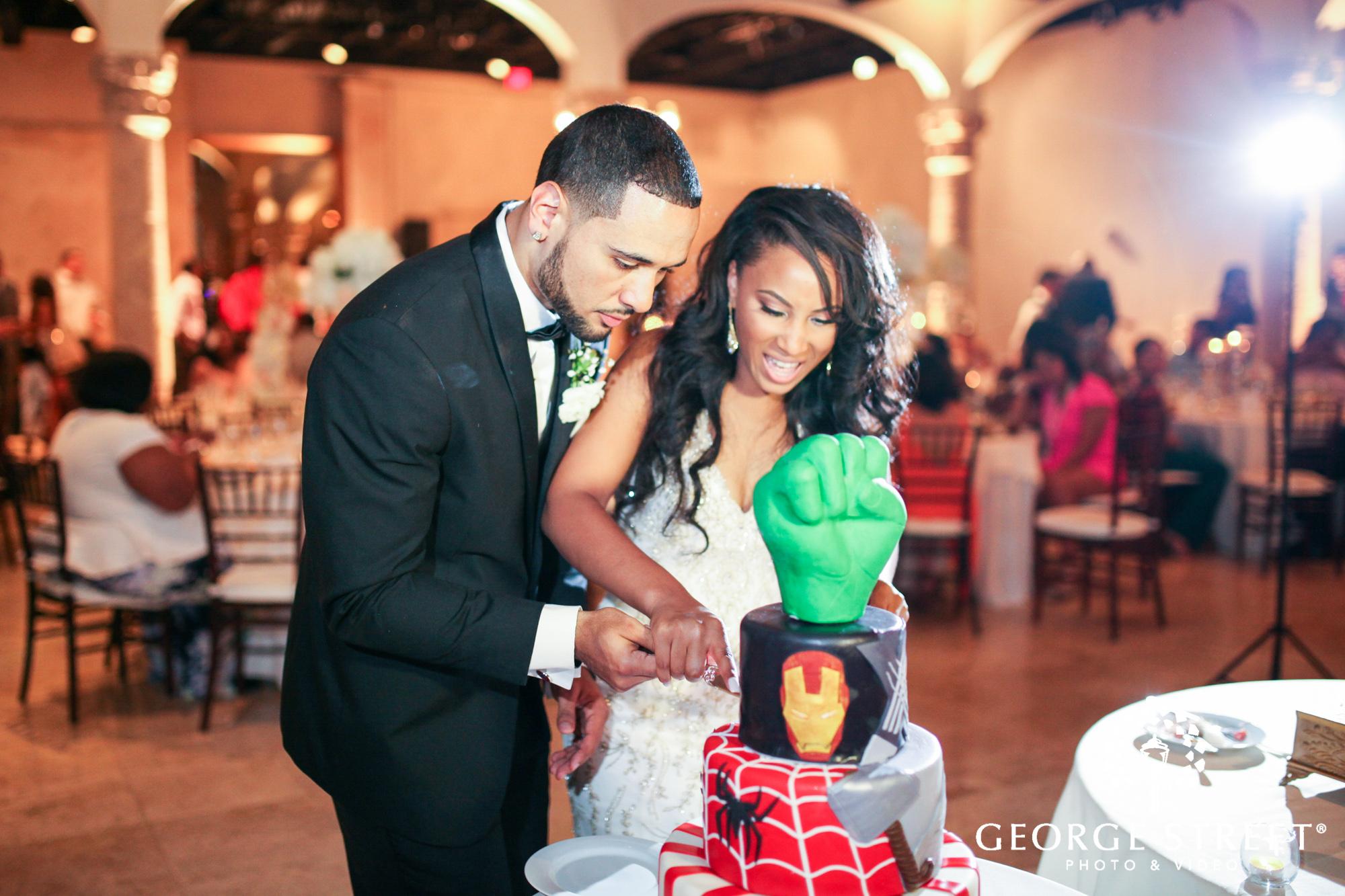 bride and groom cutting wedding cake 2