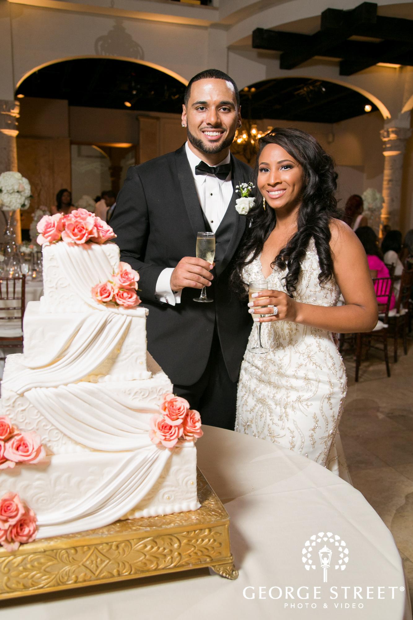bride and groom cutting wedding cake 3