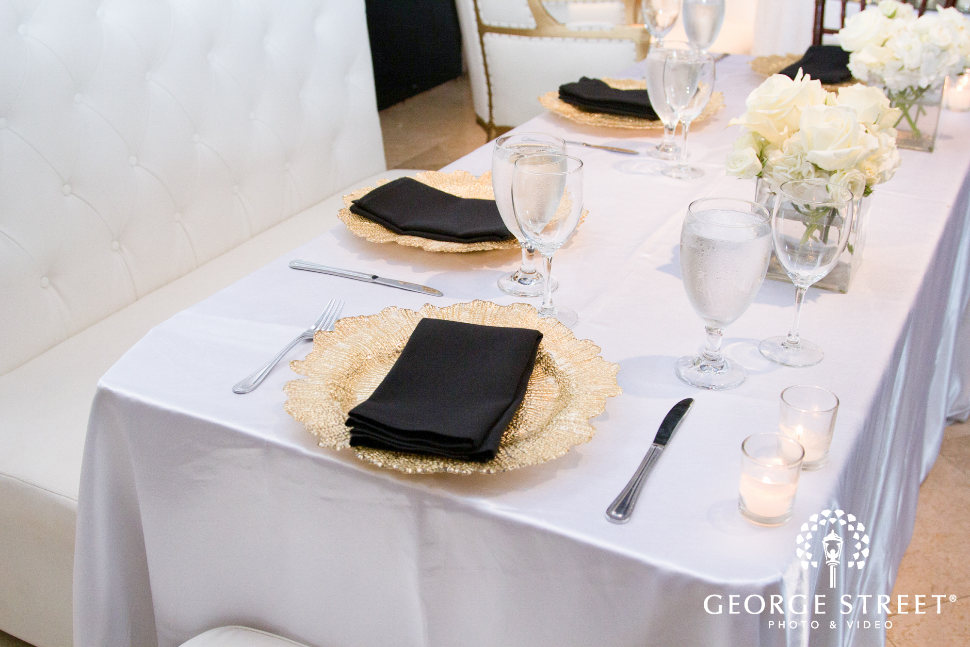 gold and black place settings