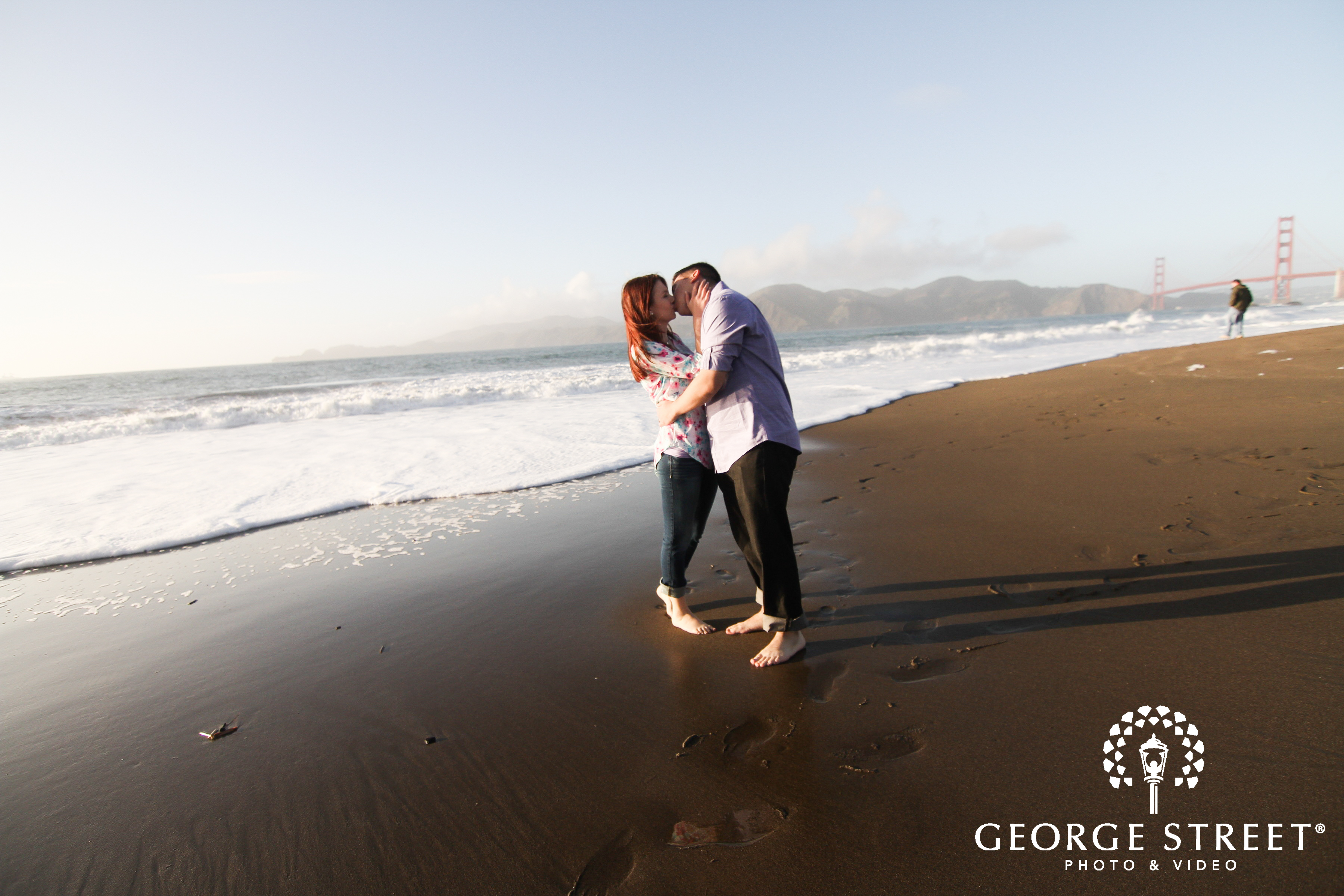 couple kissing on the beach san francisco