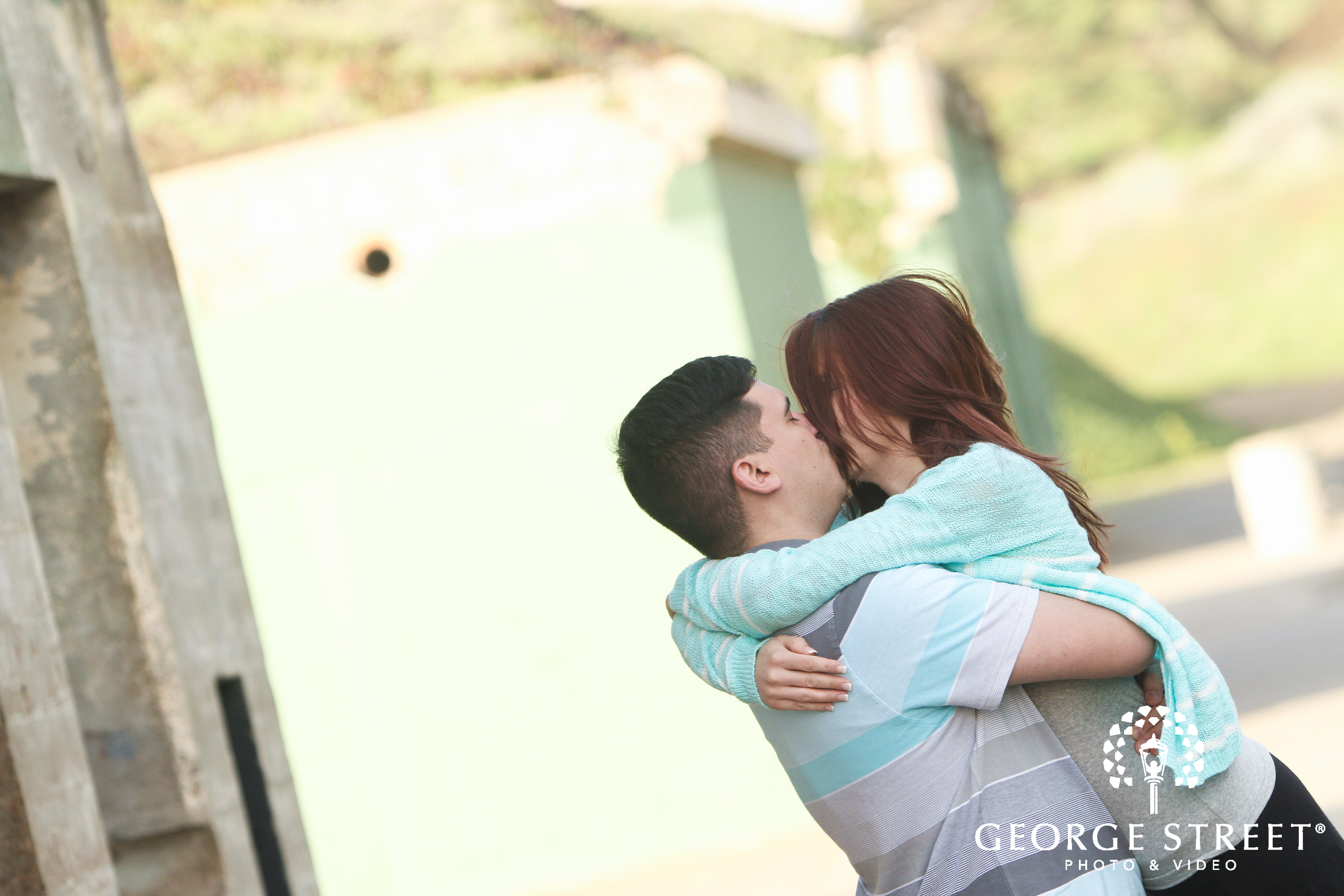 cute couple kissing in photo session