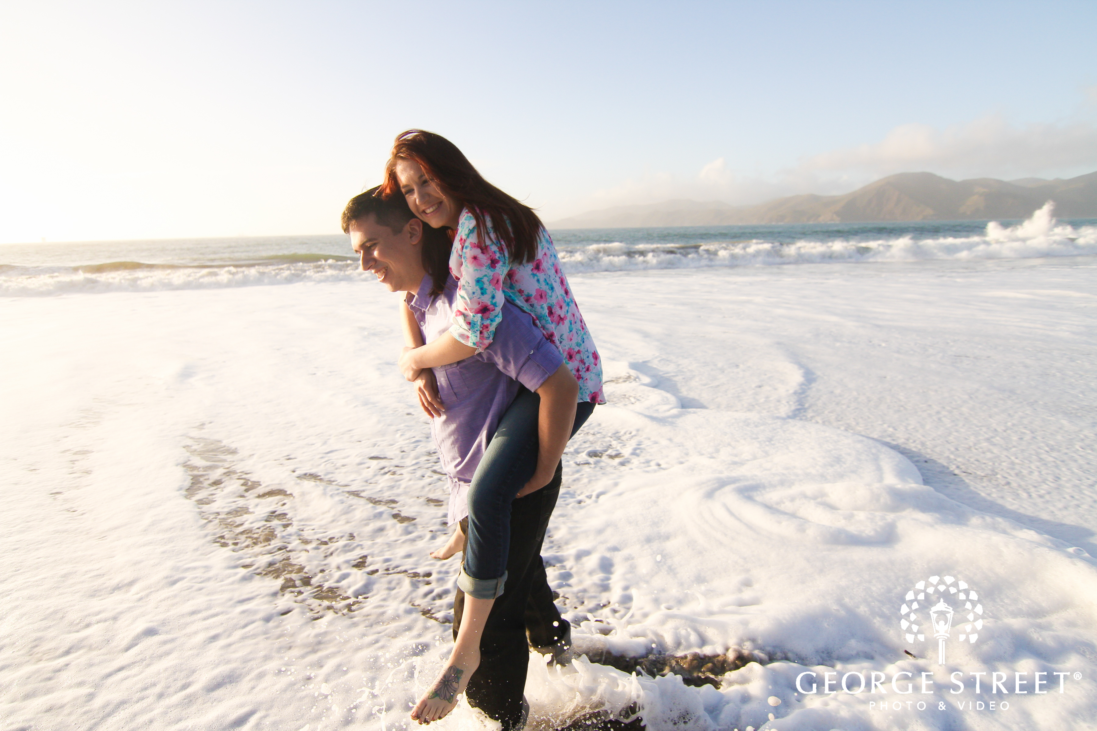 fun couple at beach engagement session