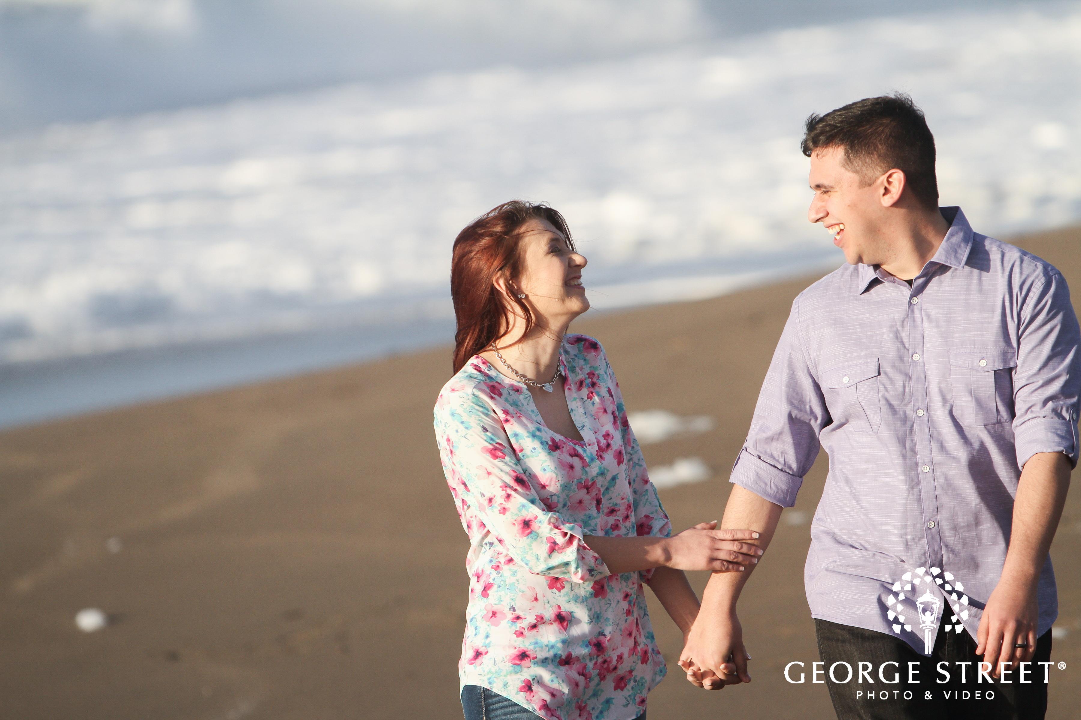 fun loving couple at beach