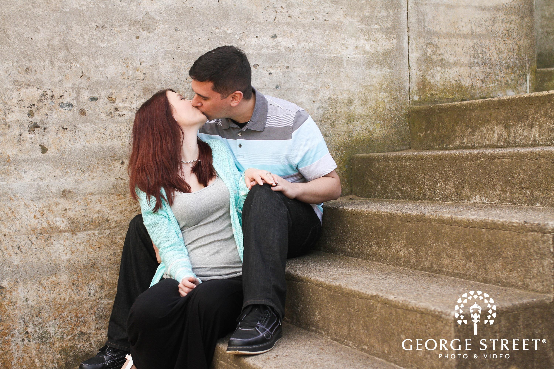 adorable couple kissing on steps